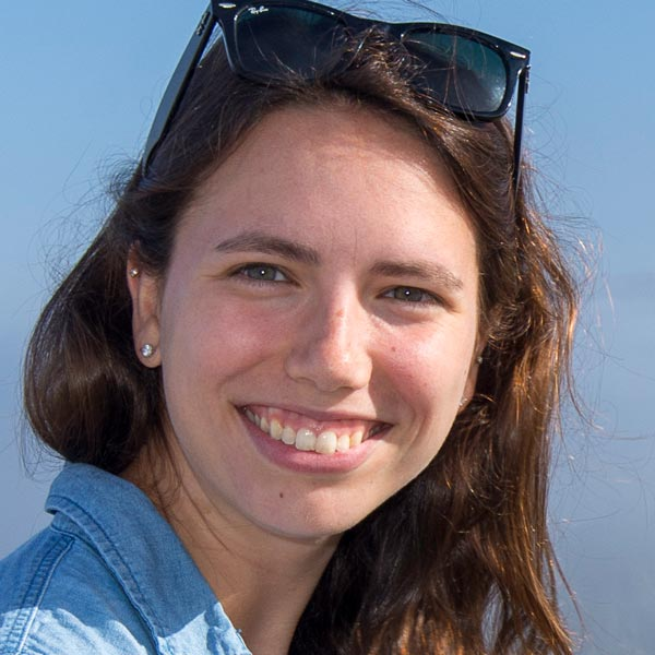 Allison Tanner headshot with landscape background